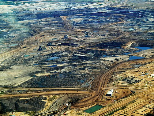 Tar sands in Alberta, 2008. Oil is one of the most used resources by humans. Tar sands in alberta 2008.jpg