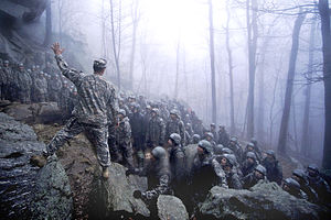 Ranger School - An instructor explains the technical aspects of rappelling to his students during the Mountain Phase of Ranger School (April 2009)