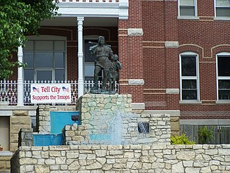 Tell City, Indiana - A statue of William Tell and his son sits upon a fountain outside city hall. It is a famous city landmark.