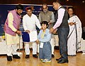 Thaawar Chand Gehlot presenting the awards to the winners of 'Drawing and Painting Competition' for student including students with disabilities.jpg