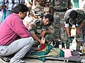 The Army doctors provide medical help to a seriously ill pilgrim, in Gauchar, Uttarakhand.jpg