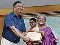 The Chairman, Lalit Kala Akademi, Ministry of Culture, Shri K.K. Chakravarty conferring the fellowship on eminent artist Arpita Singh, at a function, in New Delhi on October 10, 2014.jpg