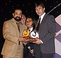 The Chief Guest and renowned film actor Sh. Kamal Haasan presenting the Golden Peacock to Kazakhastan Director Sergie Dvortsevoy. The Director also won the Silver Peacock for the most Promising director at 39th IFFI-2008 at.jpg
