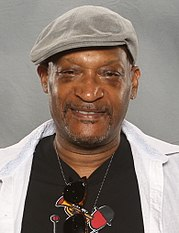 Tony Todd, an African-Americal male, is looking directly at the camera wearing a hat.