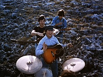 The Beatles - The US trailer for Help! with (from the rear) Harrison, McCartney, Lennon and (largely obscured) Starr