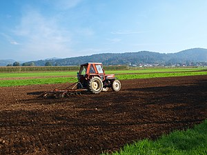 Tractor - A tractor pulling a chisel plow in Slovenia.