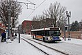 TriMet bus on NW 6th Ave during Feb 2014 snowstorm, passing MAX station.jpg