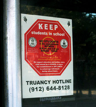 Truancy - Truancy hotline road sign in Savannah, Georgia, US