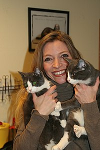 Trude Mostue with two cats.jpg