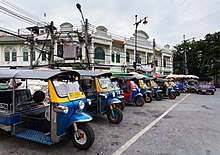 Row of Tuk-Tuks in Maha Rat St., Bangkok, Thailand.
