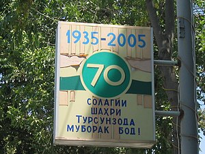 Tursunzoda - Sign celebrating 70 years of the city