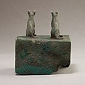 Two cats surmounting a box for an animal mummy MET 04.2.601 EGDP014449.jpg