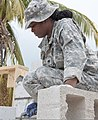 U.S. Army Spc. Brenna Bethea, an engineer with the 1023rd Vertical Engineer Company, 528th Engineer Battalion, Louisiana Army National Guard, preps mortar for laying blocks April 16, 2014, at Stella Maris School 140416-F-EE220-117.jpg