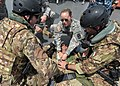 U.S. Army Spc. Nicole Stapleton, center, assigned to the 396th Combat Support Hospital, demonstrates how to treat a chest wound for boarding team members from the Italian Navy ship ITS Bettica (P 492) while on 120526-N-QD416-179.jpg