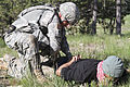 U.S. Army Spc. Robert Bickmore, left, a military police officer with the 1st Platoon, 94th Military Police Company, based out of Londonderry, N.H., searches and detains a member of the opposing forces team 130617-A-PU354-403.jpg