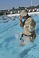 U.S. Coast Guard Machinery Technician 2nd Class James Amero, assigned to Maritime Safety and Security Team Boston, begins the swimming portion of water survival training Oct. 4, 2011, at Naval Station Guantanamo 111004-A-MI669-292.jpg