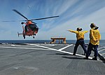 U.S. Coast Guardsmen assigned to the polar icebreaker USCGC Healy (WAGB 20) conduct deck-landing qualifications with an MH-65 Dolphin helicopter crew in Kodiak, Alaska, July 23, 2013 130723-G-KL864-142.jpg
