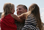 U.S. Marine Corps 1st Lt. Justin Griffis, an administrative officer with Marine Air Support Squadron 3, 3rd Marine Aircraft Wing (MAW) greets his daughters during a homecoming ceremony Aug. 23, 2012, at Marine 120823-M-XW721-030.jpg