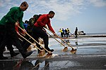 U.S. Sailors wash the flight deck of the aircraft carrier USS Ronald Reagan (CVN 76) July 22, 2013, while underway in the Pacific Ocean carrier qualifications 130722-N-ZZ999-081.jpg