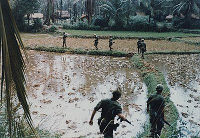 US-Army-troops-patrol-Vietnamese-rice-paddy-outside-village.jpg