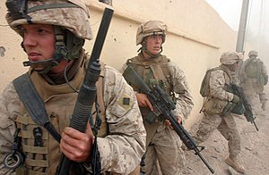 Combat shotgun - A group of US Marines in Iraq in 2005, armed with a combat shotgun, assault rifle, and squad automatic weapon