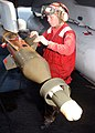 US Navy 021009-N-9593M-036 Aviation Ordnanceman ensures that stabilizers on the guidance portion of a 500 lb. GBU-12 laser-guided bomb are installed correctly.jpg