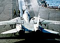US Navy 021111-N-9593M-003 A Flight Deck Director guides an F-14D Tomcat fighter onto catapult one.jpg