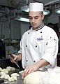 US Navy 030220-N-5027S-004 Mess Management Specialist 3rd Class Anthony Naranjo from Reno, Nev., prepares dinner rolls for the wardroom mess.jpg