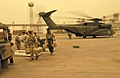 US Navy 030327-N-3783H-147 Members of Commander Task Unit (CTU-55.4.3) unload supplies during a sandstorm from an MH-53E Sea Dragon helicopter.jpg