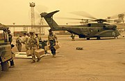 US Navy 030327-N-3783H-147 Members of Commander Task Unit (CTU-55.4.3) unload supplies during a sandstorm from an MH-53E Sea Dragon helicopter