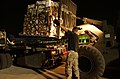 US Navy 030412-N-5362A-007 U.S. Air Force personnel load pallets of humanitarian supplies that will be flown to Baghdad.jpg