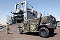 US Navy 030709-N-5362A-012 A U.S Marine humvee assigned to the 1st Marine Expeditionary Force (1st MEF) drives into the cargo bay of the military sealift command ship.jpg