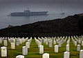 US Navy 030912-N-6213R-112 The decommissioned Constellation (CV 64) is towed past Fort Rosecrans National Cemetery in Point Loma, Calif.jpg
