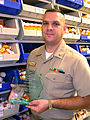 US Navy 031031-N-3902D-002 Lt. Cmdr. Anthony Capano displays his Senior Navy Pharmacist of the Year plaque that he was awarded at Naval Hospital Pensacola, Fla.jpg