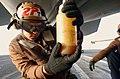 US Navy 031101-N-4768W-141 Aviation Electronics Technician Airman Cole Bailey, from Aberdeen, Wash., inspects F-A-18 Super Hornet engine oil on the flight deck of USS John C. Stennis (CVN 74).jpg