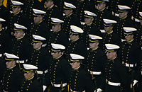 US Navy 031121-N-9693M-001 U.S. Naval Academy Midshipmen stand at parade-rest