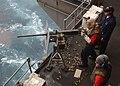 US Navy 040424-N-1045B-035 Sailors shoot a .50-caliber machine gun off the fantail during a training exercise aboard USS George Washington (CVN 73).jpg