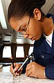 US Navy 040808-N-5821P-122 Operations Specialist Seaman Janelle E. Nelson of Abbeville, S.C., uses a divider to plot the exact position of the Military Sealift Command oiler USNS Yukon (T-AO 202) in the western Pacific Ocean.jpg