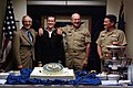 US Navy 041004-N-2383B-064 MCPON, SECNAV and CNO join Seaman Anthony J. Tobias as they commemorate the Navy's upcoming 229th Birthday.jpg