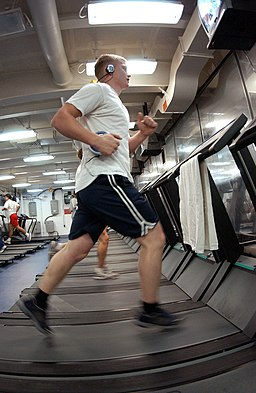 US Navy 041110-N-0413R-001 Machinist Mate 3rd Class Lorne Semrau of Harrisburg, Pa., keeps in shape while underway by working out one of the many treadmills aboard USS Nimitz (CVN 68)