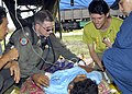 US Navy 050103-N-9951E-191 Lt. Mark Banks, of Savannah, Ga., tends to a patient who was medically evacuated by U.S. Navy helicopter to a temporary triage site in Aceh, Sumatra, Indonesia.jpg