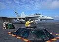US Navy 050228-N-1229B-052 A catapult shooter signals for the launch of an F-A-18C Hornet on the flight deck aboard the Nimitz-class aircraft carrier USS Abraham Lincoln (CVN 72).jpg