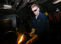 US Navy 051208-N-9641C-003 Hull Maintenance Technician Fireman Todd Goodrich lights a brazing torch in preparation of welding pipes together in the sheet metal shop aboard the Nimitz-class aircraft carrier USS Dwight D. Eisenho.jpg