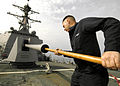 US Navy 060418-N-7981E-021 Gunner's Mate 2nd Class Michael West cleans the barrel of an MK-45 5-inch-54-caliber gun on the foc'sle of the Arleigh Burke-class guided missile destroyer USS Shoup (DDG 86).jpg