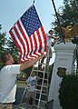 US Navy 060825-N-2383B-025 Newly selected U.S. Navy Chief Petty Officer (CPO) from the Washington, D.C. area, accompanied by their CPO mentors, place new flags at the entrance to the Armed Forces Retirement Home in Washington.jpg