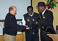 US Navy 070118-N-0857S-005 Commanding Officer Capt. Scott Beyer, Naval Support Activity New Orleans, receives the Zulu coconut from Larry Hammond, 2007 King of the Zulu Social Aid and Pleasure Club, and Clarence Becknell, Zulu.jpg