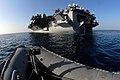 US Navy 070306-N-0684R-077 Boatswain's mates assigned to deck department steer a rigid hull inflatable boat (RHIB) toward the back end of Nimitz-class aircraft carrier USS John C. Stennis (CVN 74).jpg