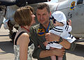US Navy 070521-N-1082Z-005 Lt. Cmdr. John Fisher greets his wife and seven-month-old daughter at a flight line homecoming on Naval Station Norfolk after returning with the Rawhides of Fleet Logistics Support Squadron (VRC) 40.jpg