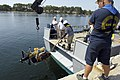 US Navy 070611-N-7676W-023 Remote Environmental Monitoring Units (REMUS) with an autonomous docking station from Woods Hole Oceanographic Institution (WHOI) is lowered into the water pierside during the Autonomous Underwater Ve.jpg