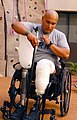 US Navy 071012-N-8327R-048 Spc. Saul Martinez, who sustained injury during combat, attaches his prosthetic leg after climbing the new 30-foot wall in the Comprehensive Combat and Complex Casualty Care (C5) facility.jpg